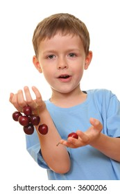 five years old boy and fresh cherries isolated on white