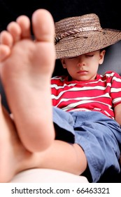 Five years old child sleeping with hat comfortably