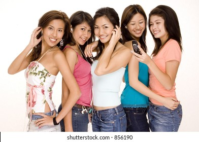 Five young asian women with phones and mp3 players