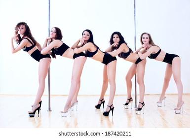 Five young pole dance women.