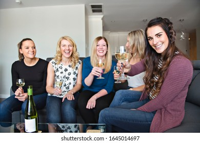 Five young women toast and celebrating their meeting
