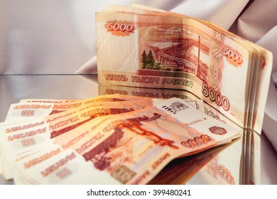 five-thousandth banknotes reflected in the mirror