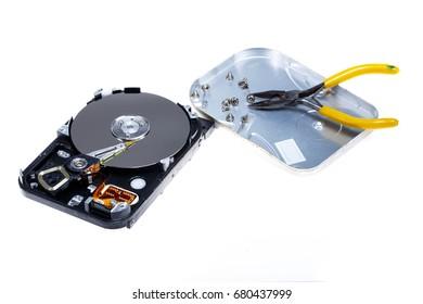 fix hard disk open hard disk inside hard disk laboratory hard disk  Close-up Of Person Hands Repairing Harddisk Using Screwdriver At Desk