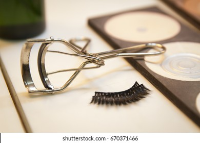 Fixation forceps and false eyelashes in the makeup room.
