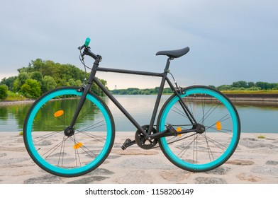Fixed bicycle  by the river. Tranquil landscape