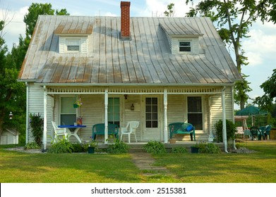 Fixer Upper - Bungalow in the Country - A cute old wood siding bungalow in the country that a realtor would refer to as a fixer-upper.