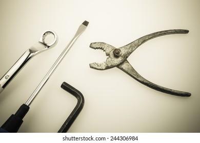 fixing tools arranged on plain background