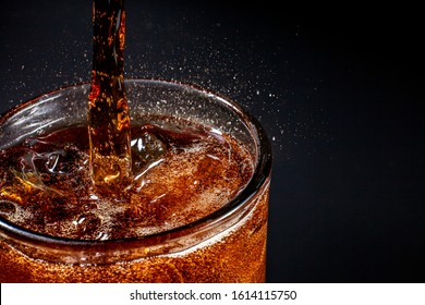 Fizz sparkling Cola water Refreshing bubbly Soda Pop with Ice Cubes. Cold soft drink cola carbonated liquid fresh and cool iced drink in a glasses . Refreshing and quench thirst concept .