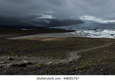 Fjallsarlon glacier lagoon, view of Fjallsarlon lake and Vatnajokull glacier, Iceland, mountains on background