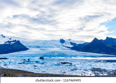 The Fjallsarlon iceberg lagoon at the south end of the glacier Vatnajokull, with floating icebergs that calve from the edge of the glacier.  Fjallsarlon iceberg lagoon at the summertime.
