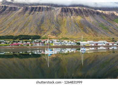 Fjord and boats reflection at Isafjordur town, Iceland