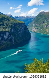 Fjord Geirangerfjord with cruise ship, view from Ornesvingen viewing point, Norway. Travel destination
