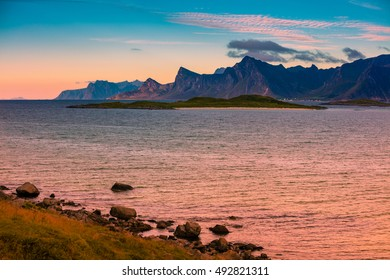 Fjord at sunset, Rocky beach in evening, Norway