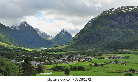 Fjord view with small town in the valley