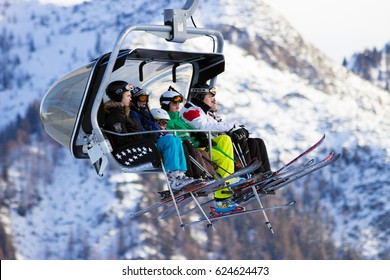 FLACHAU, AUSTRIA - DEC 27, 2012: Skiiers on a ski lift to a piste in the Austrial Alps. These pistes are part of the Ski Armada network, the largest of Europe
