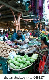 FLACQ, MAURITIUS-JUNE 23: Indian people search for a bargains in the market hall on June 23, 2013 in Flacq, Mauritius