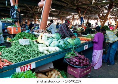 FLACQ, MAURITIUS-JUNE 23: Indian people and tourists search for a bargains in the market hall on June 23, 2013 in Flacq, Mauritius