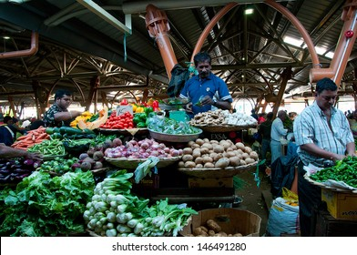 FLACQ, MAURITIUS-JUNE 23: Shopping day at Flacq market which is on Mauritius one of largest vegetable markets June 23, 2013 in Flacq, Mauritius