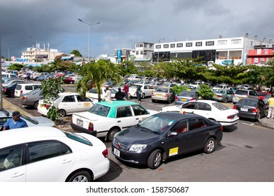 FLACQ, MAURITIUS-JUNE 23: Shopping day at Flacq market. A lot of turists go to Flacq market by taxi June 23, 2013 in Flacq, Mauritius