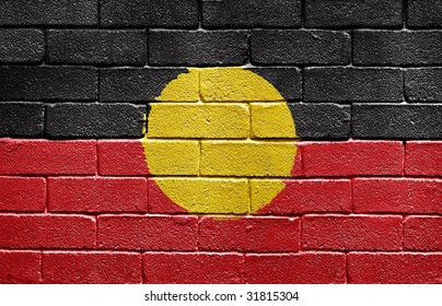 Flag of Aborigines painted onto a grunge brick wall