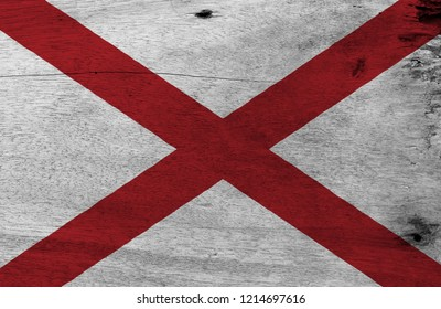 Flag of Alabama on wooden plate background. Grunge Alabama flag texture, The states of America,  Red St. Andrew's saltire in a field of white.