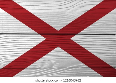 Flag of Alabama on wooden wall background. Grunge Alabama flag texture, The states of America,  Red St. Andrew's saltire in a field of white.
