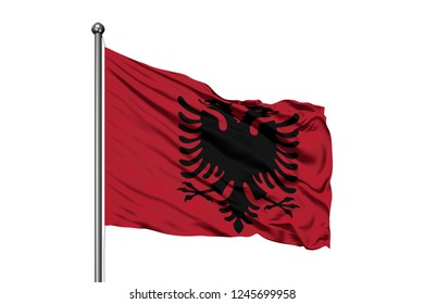 Flag of Albania waving in the wind, isolated white background.