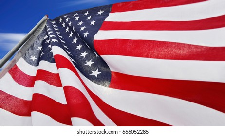 Flag American waving in the sky isolated on blue sky background. This has clipping path.