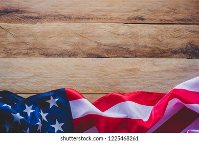 Flag of the Americas Lay on a wooden floor.