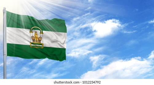 Flag of Andalusia on flagpole against the blue sky