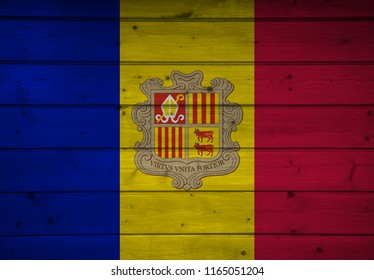 Flag of Andorra on wooden background, surface. Wooden wall, planks. National flag.