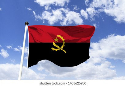 Flag of Angola, half red and half black, in the center a cogwheel, a catana, and a star, the set symbolizes the workers, official representation of the country, fluttering under the blue sky.