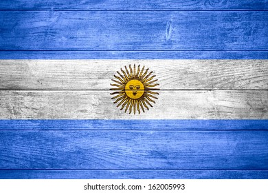 flag of  Argentina or  Argentinian banner on wooden background