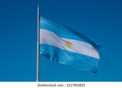 The flag of Argentina (Bandera argentina - Bandera Nacional) is a horizontal triband of light blue (top and bottom) and white with the Sun of May centered on the white band. Buenos Aires, Argentina