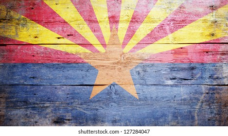 Flag of Arizona painted on grungy wooden background
