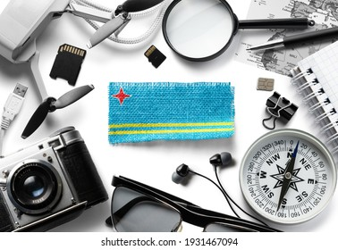 Flag of Aruba and travel accessories on a white background.