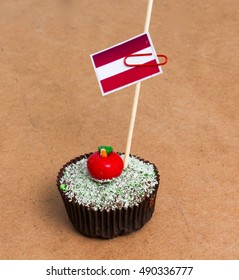 Flag of Austria. Apple Cupcake with red apple shape bonbon on the top