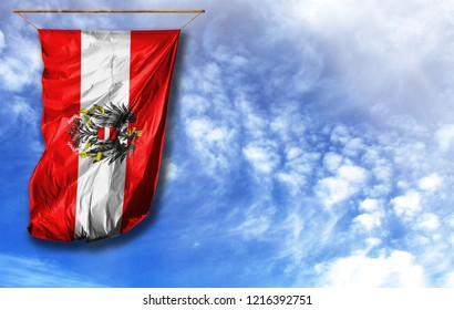 Flag of Austria. Vertical flag, against blue sky with place for your text