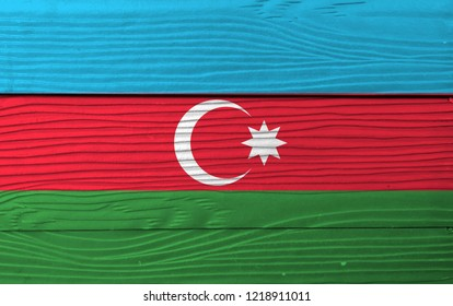 Flag of Azerbaijan on wooden wall background. Grunge Azerbaijan flag texture, blue red and green with a white crescent and big star.
