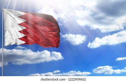 Flag of Bahrain on a flagpole against a blue sky, with a good place for your text.