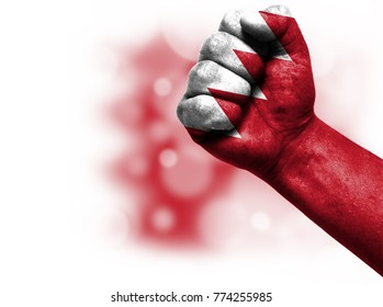 Flag of Bahrain painted on male fist, concept of conflict