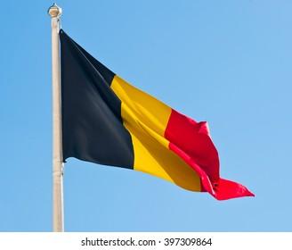 Flag of Belgium against blue sky