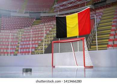 Flag of Belgium in hockey arena with puck and net