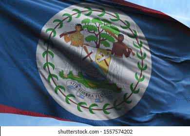 Flag of Belize fabric waving in the blue sky. National Flag of Belize for Independence day.