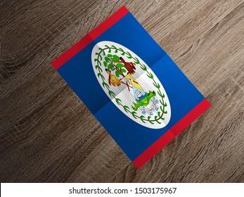 Flag of Belize on paper. Belize Flag on wooden table.