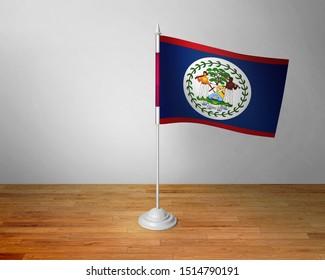 Flag of Belize Table. Belize Desk Flag on Wooden Table.