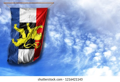 Flag of Benelux. Vertical flag, against blue sky with place for your text