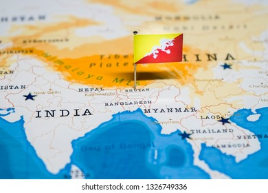 the Flag of bhutan in the world map