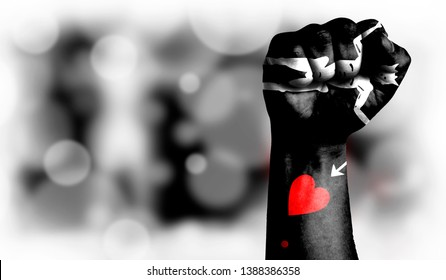 Flag of Blackbeard Pirate painted on male fist, strength,power,concept of conflict. On a blurred background with a good place for your text.