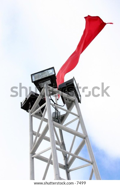 flag blowing on tower lights